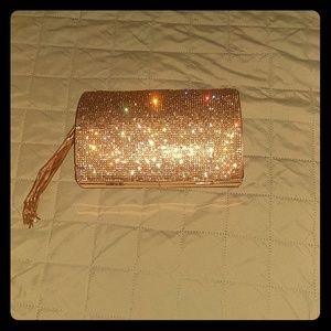 Handbags - Rose gold clutch with tassel